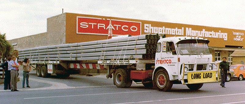 Stratco Sheet Metal Manufacturing Building with delivery truck exiting driveway