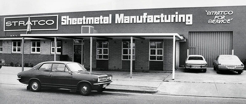 Stratco Sheet Metal Manufacturing Building with vintage car parked in front